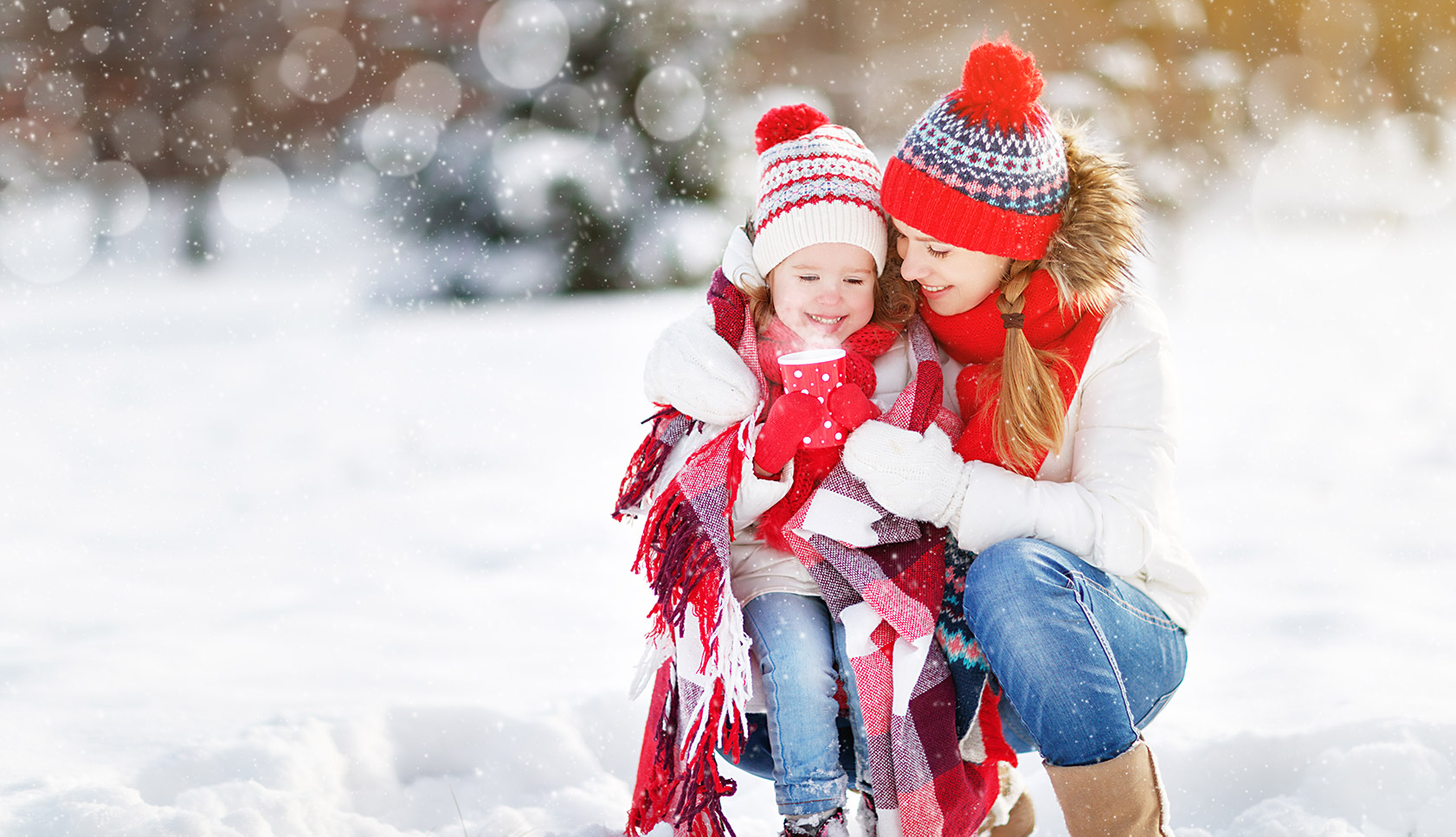 women with a little kid in snow